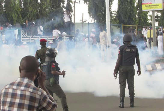 Photos: Saraki, others teargass during protest in Abuja 5